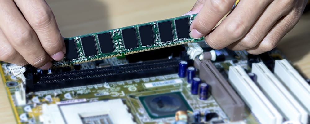 Man putting RAM on the motherboard